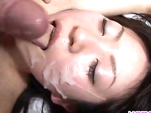 Japanese AV Model gets a lot of cum on face..