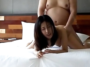 Fat guy fucks young Asian babe -..