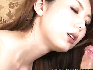 Mature asian on her knees sucking cock with..